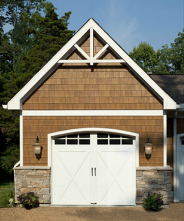 The Benefits Of Clopay Coachman Carriage House Door