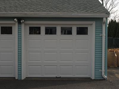 ... Artisan Advantage bi-fold appearance & General Doors Advantage Steel Raised Panel Garage Door - Jolicoeur